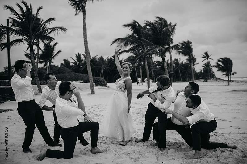 Groomsmen celebrate the bride on the beach