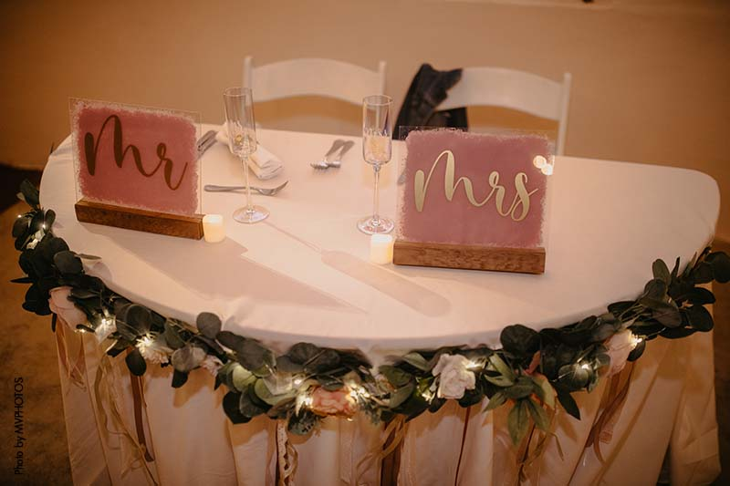 """Gold and pink acrylic """"Mr."""" and """"Mrs."""" sweetheart table signs"""