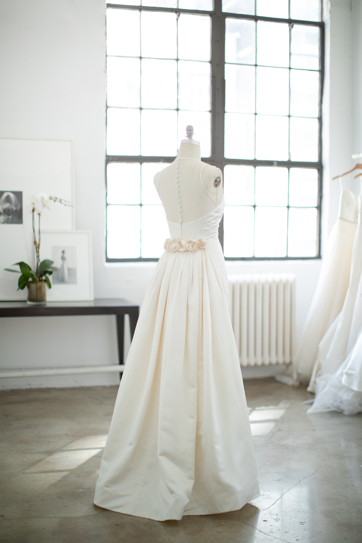 Classic weding gown with roses on lower back
