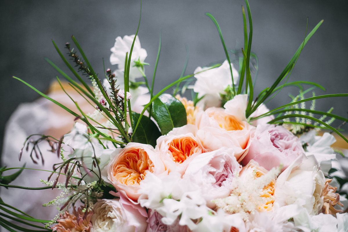 Pink white and peach rose bridal bouquet
