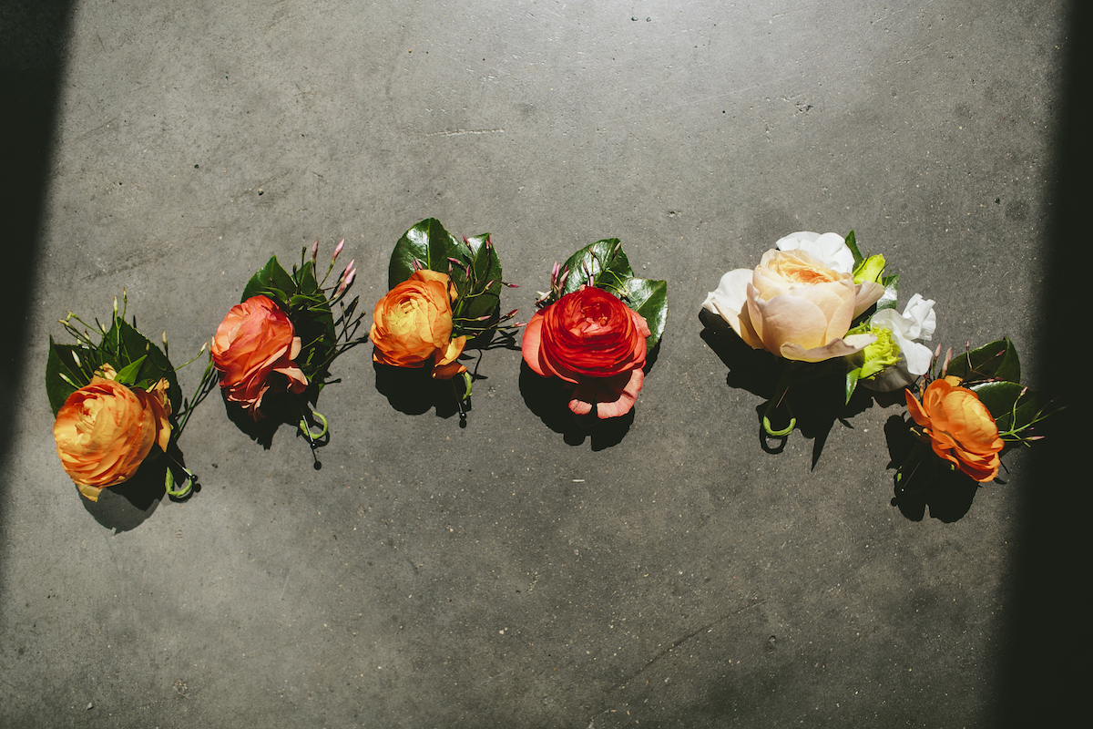 Rose, white, and red boutonnieres