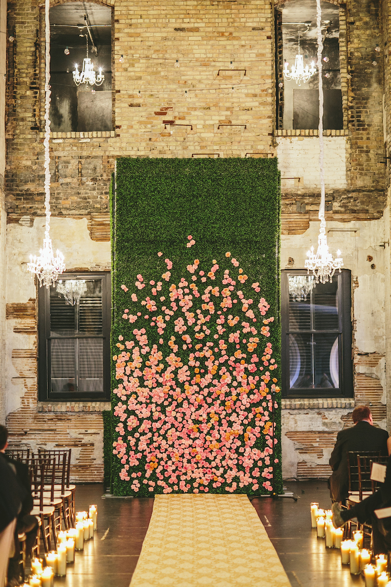 Greenery wall with rose, white, and yellow roses