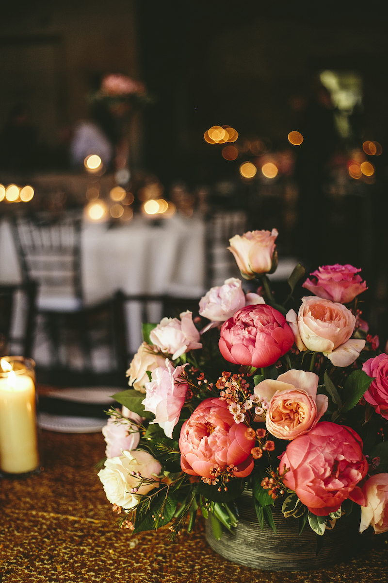 Pink, white, and peach rose bouquet on wedding tabl