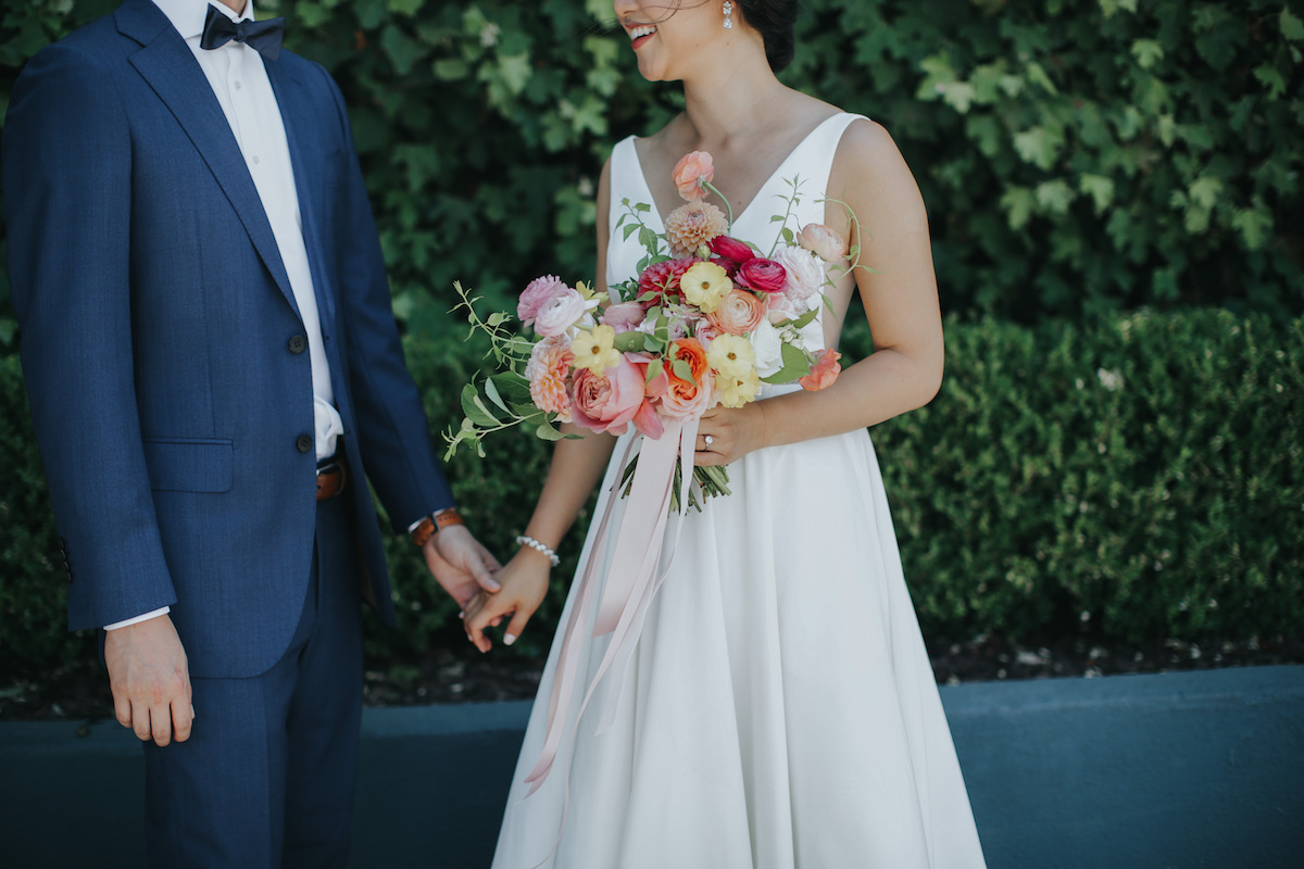 Yellow, pink, and peach bridal bouquet