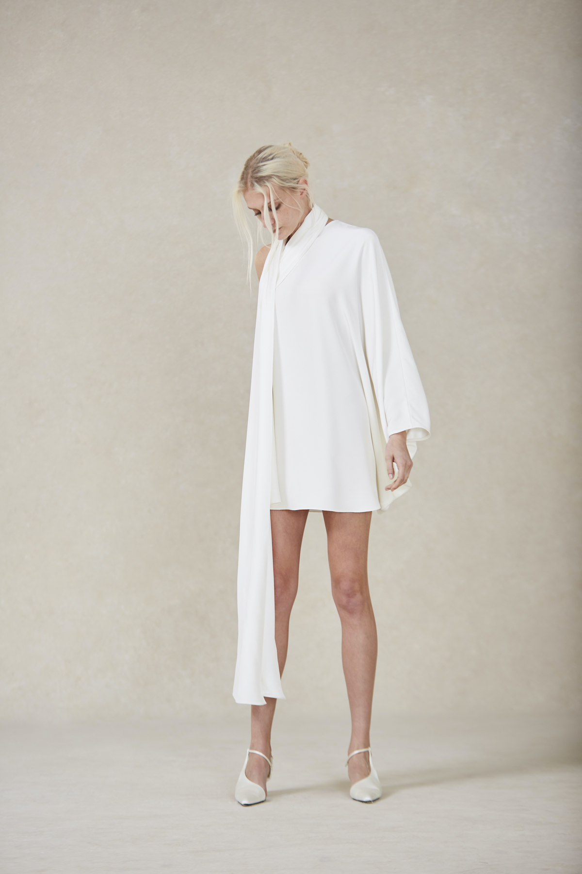 High-neck long-sleeved short bridal gown trends from bridal fashion week 2021
