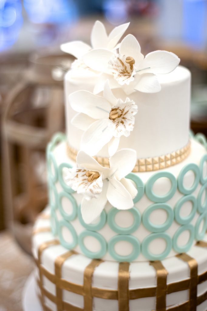 Teal and gold wedding cake with orchid sugar flowers