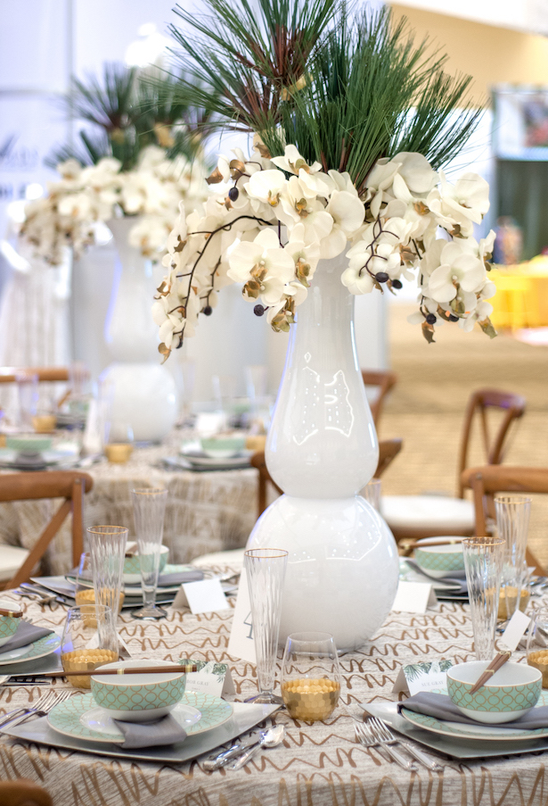 Phalaenopsis orchids and Papyrus grasses centerpieces