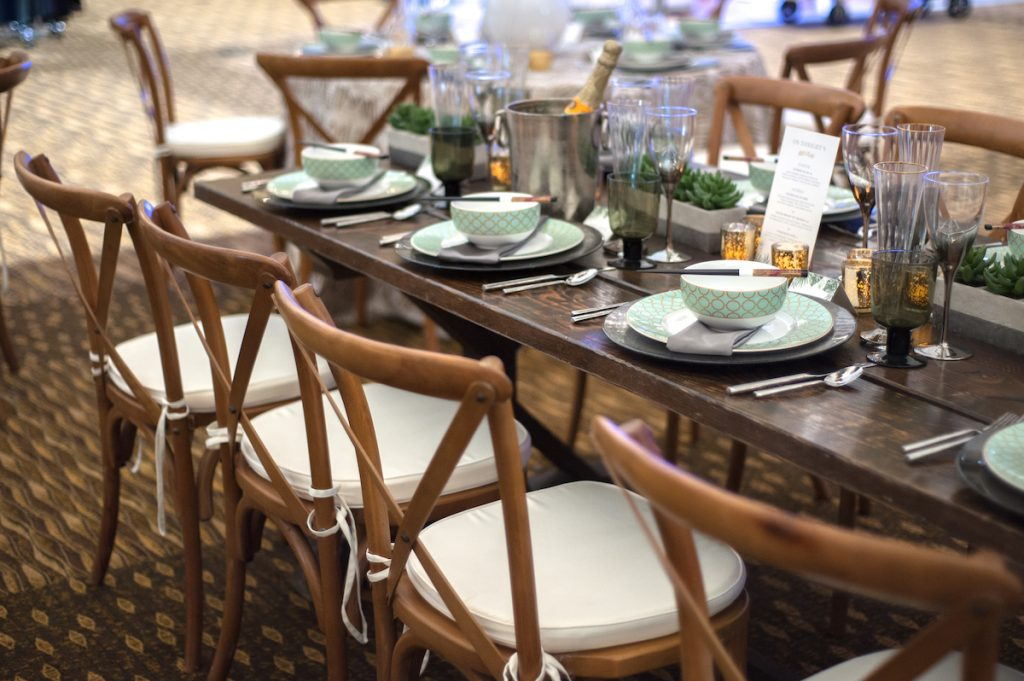 Wooden cross back chairs at wedding
