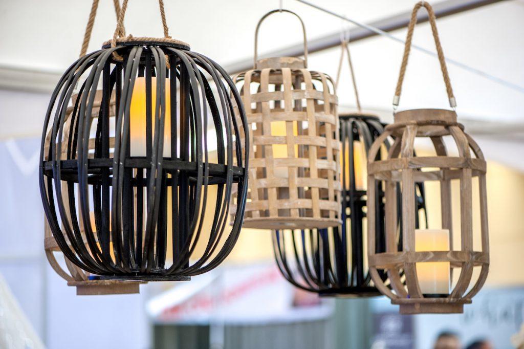 Outdoor lanterns hang over wedding table
