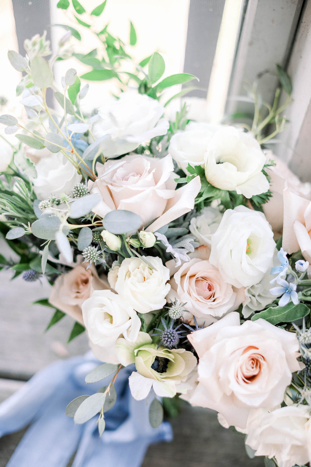 Light and airy bridal bouquet with blush and pale blue
