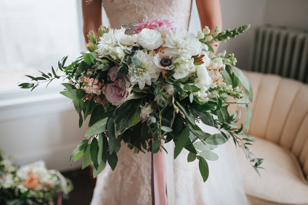 Dramatic bridal bouquet with greenery and anemones
