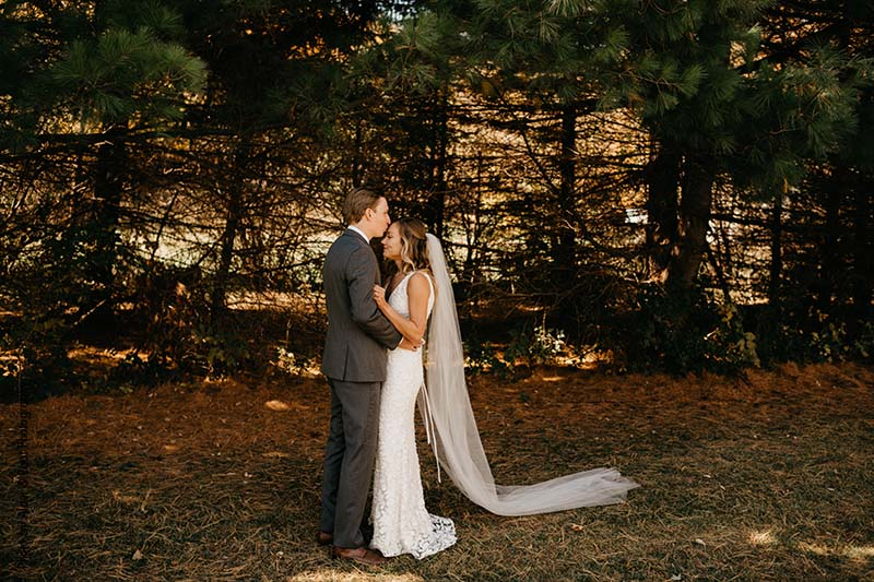 Bride and groom at outdoor fall wedding