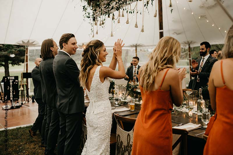 Bride and groom stand up at head table