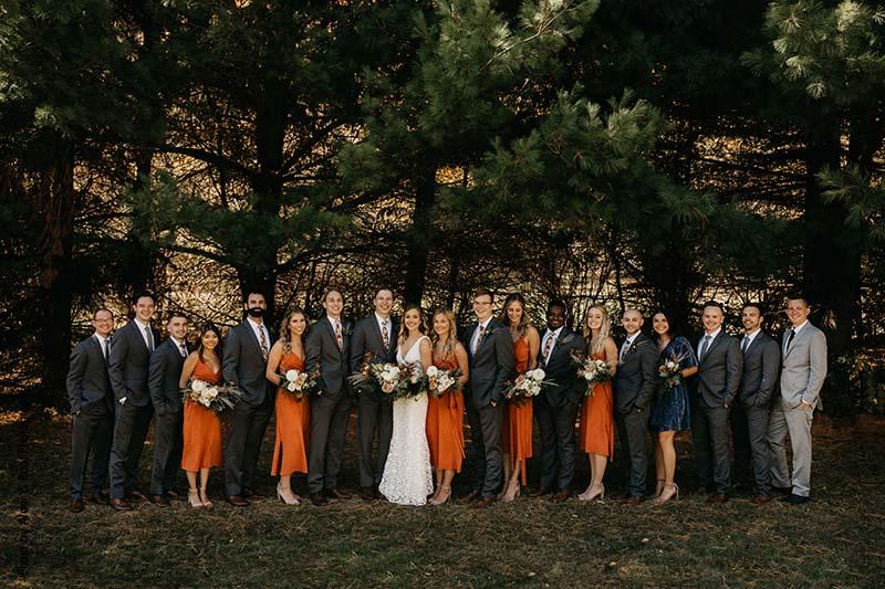 Boho bridal party in orange and dark gray