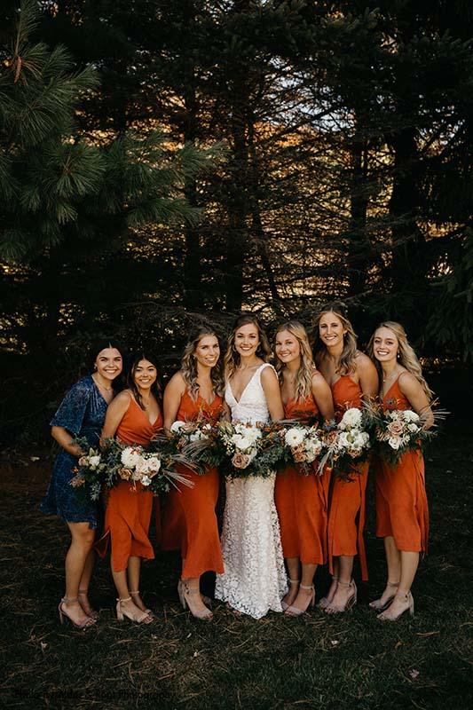 Orange midi bridesmaids dresses