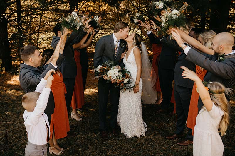 Wedding party celebrates the new bride and groom