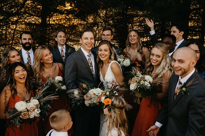 Wedding party poses with bride and groom