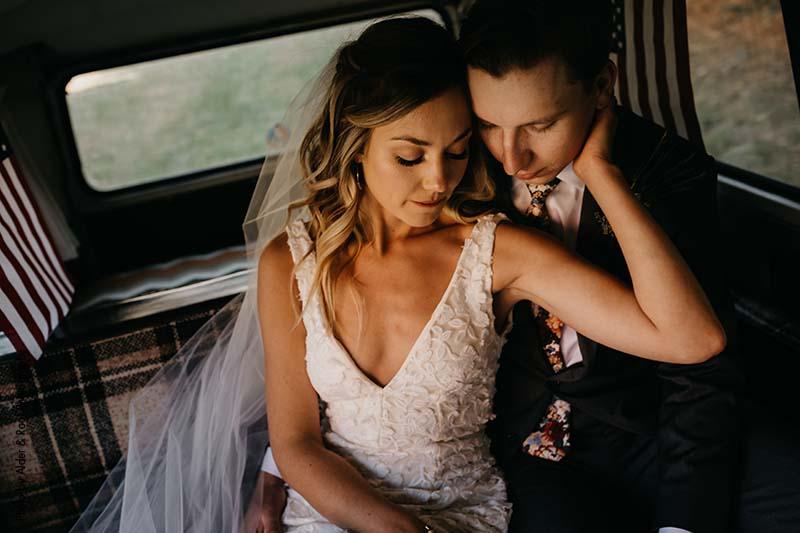 Bride and room pose in Volkswagen van