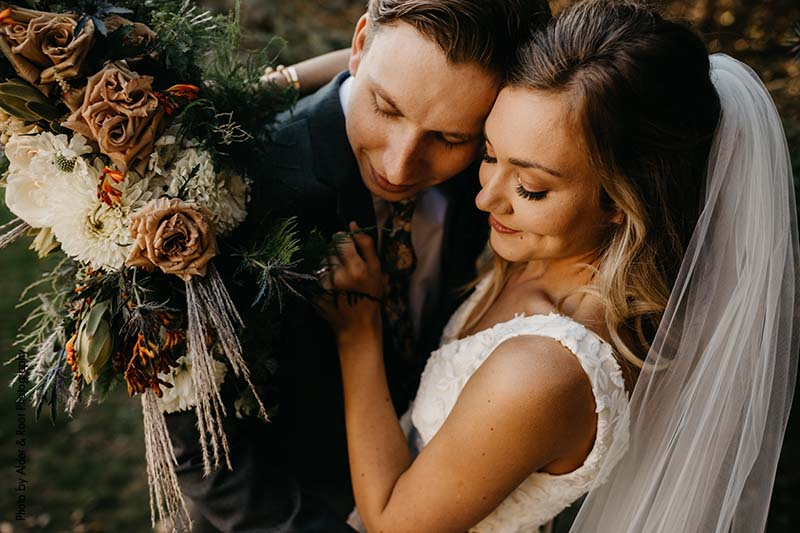 Fall bride and groom with boho bridal bouquet