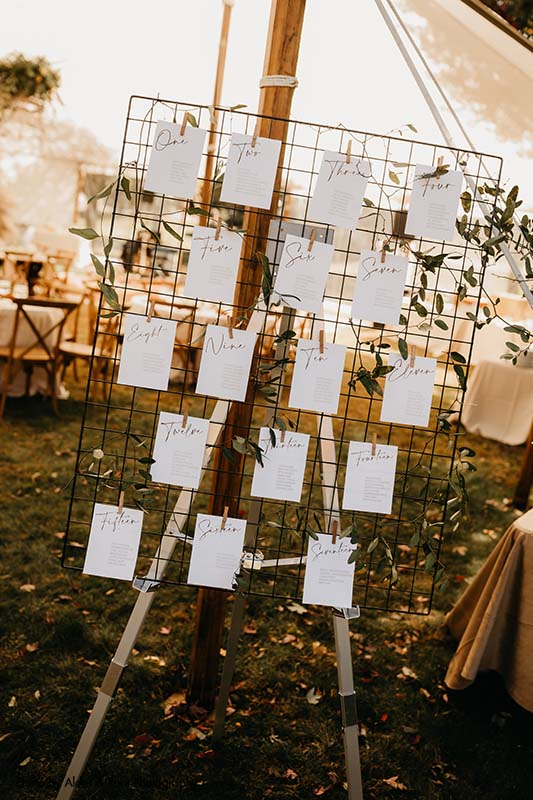 Simple and modern white and black seating chart signs