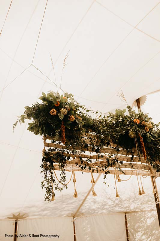 Boho floral installation at wedding reception