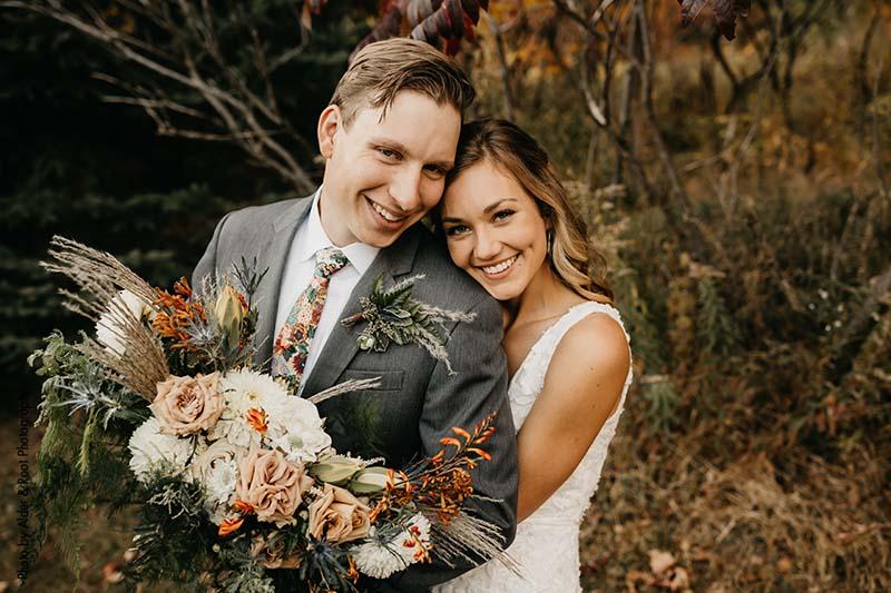 MN couple celebrates boho outdoor wedding