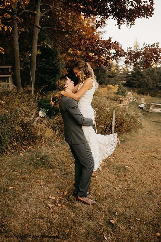 Bride and groom at fall Minnesota wedding