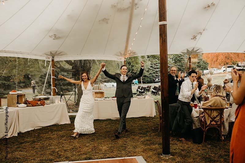 Bride and groom make entrance after outdoor wedding ceremony