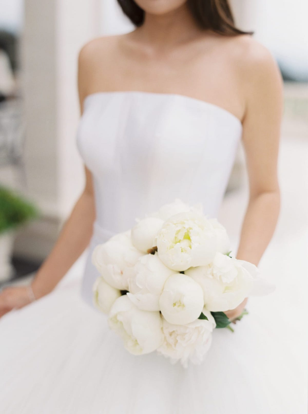 Spring bridal bouquets with all-white peonies