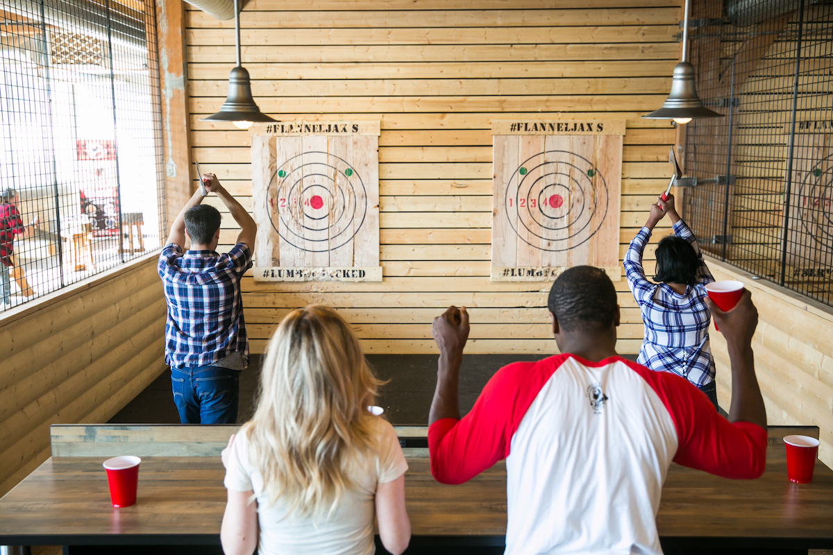 Group of people throw axes