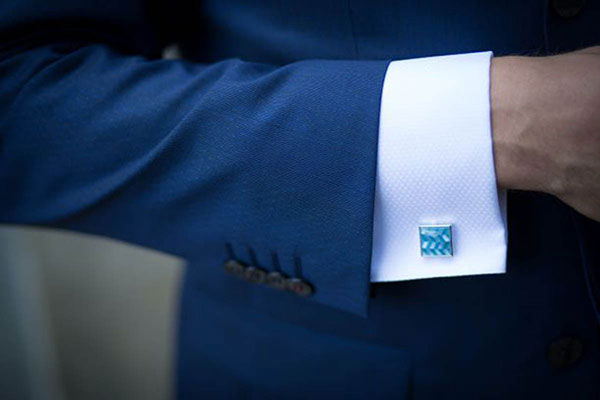 Light blue jewel cuff link on white button up from Daniel's Custom Clothing