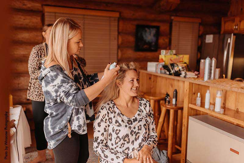 Bride gets her hair done before wedding