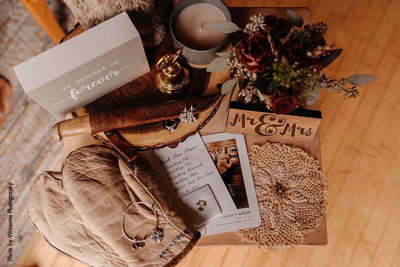 Bridal accessory details including rings, gloves, bracelets, and invitations