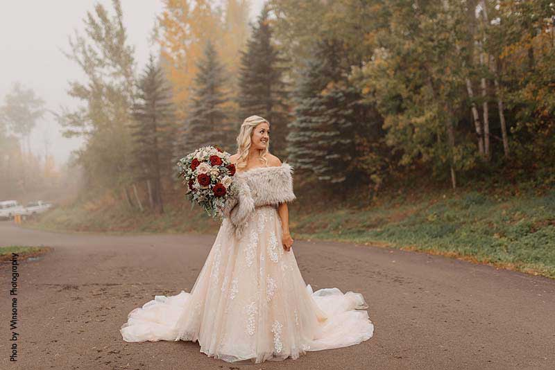 Bride in princess ballgown with beading and tulle