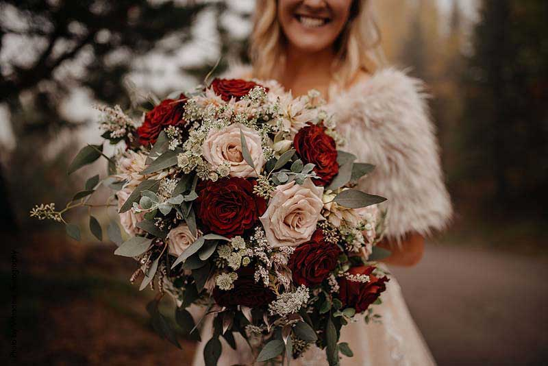 Fall bouquet with red and blush roses and greenery