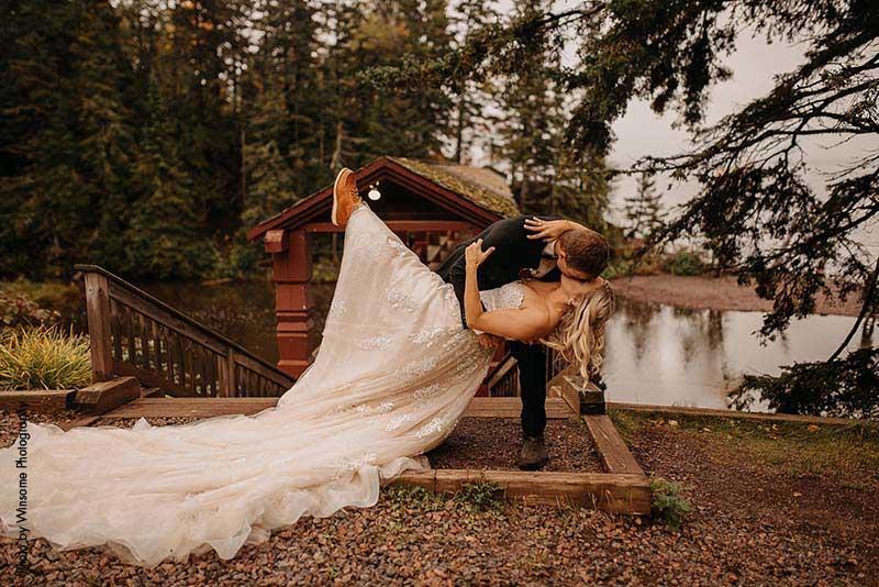 Groom dips bride for kiss