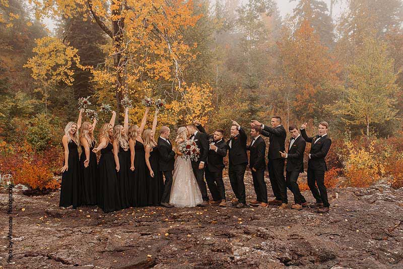 Wedding party celebrates the bride and groom