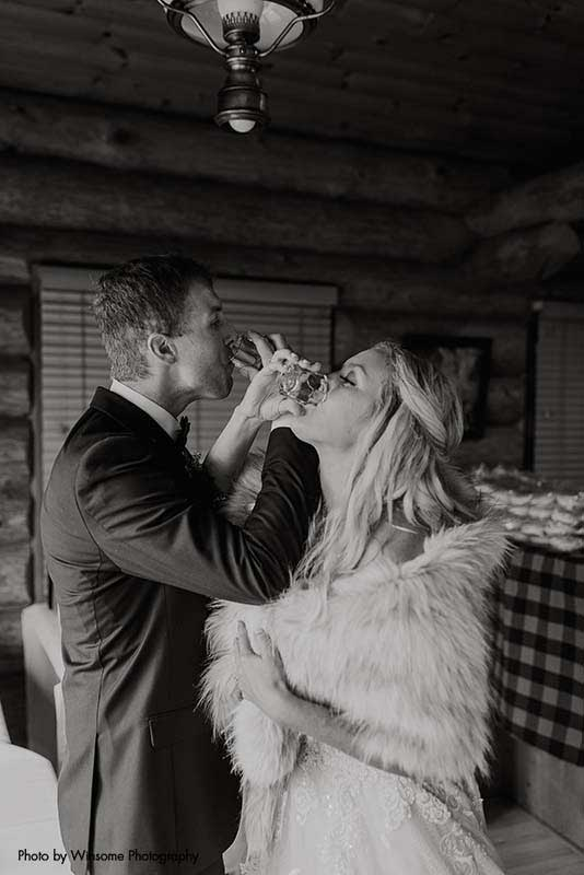 Bride and groom take whiskey shots after North Shore wedding