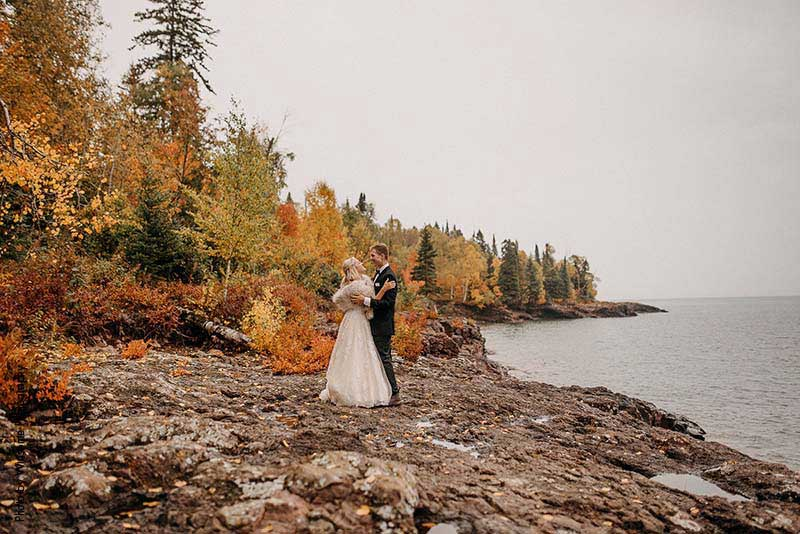 Bride and groom on the shores of Lake Superior