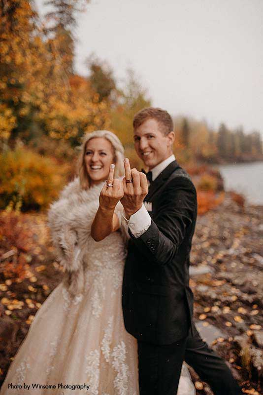 Bride and groom show off rings after Minnesota wedding ceremony