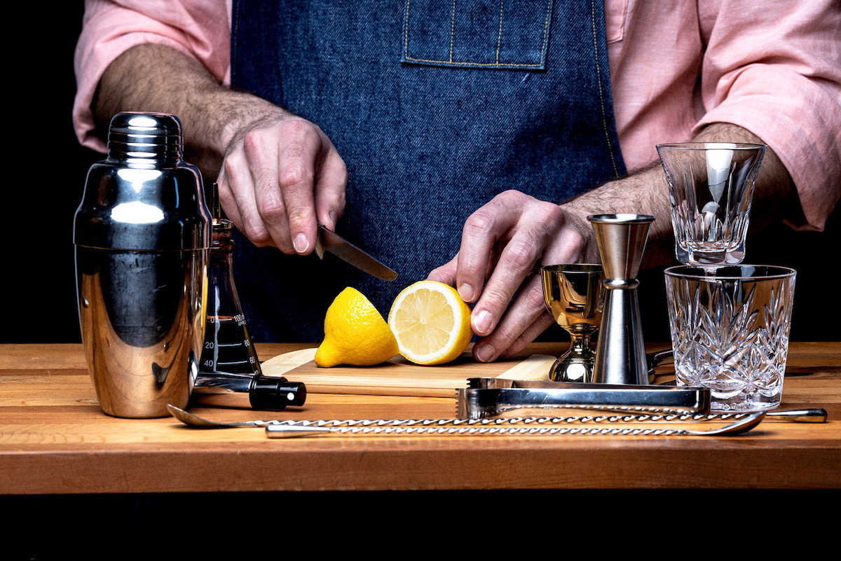 Bartender prepares ingredients for virtual cocktail class