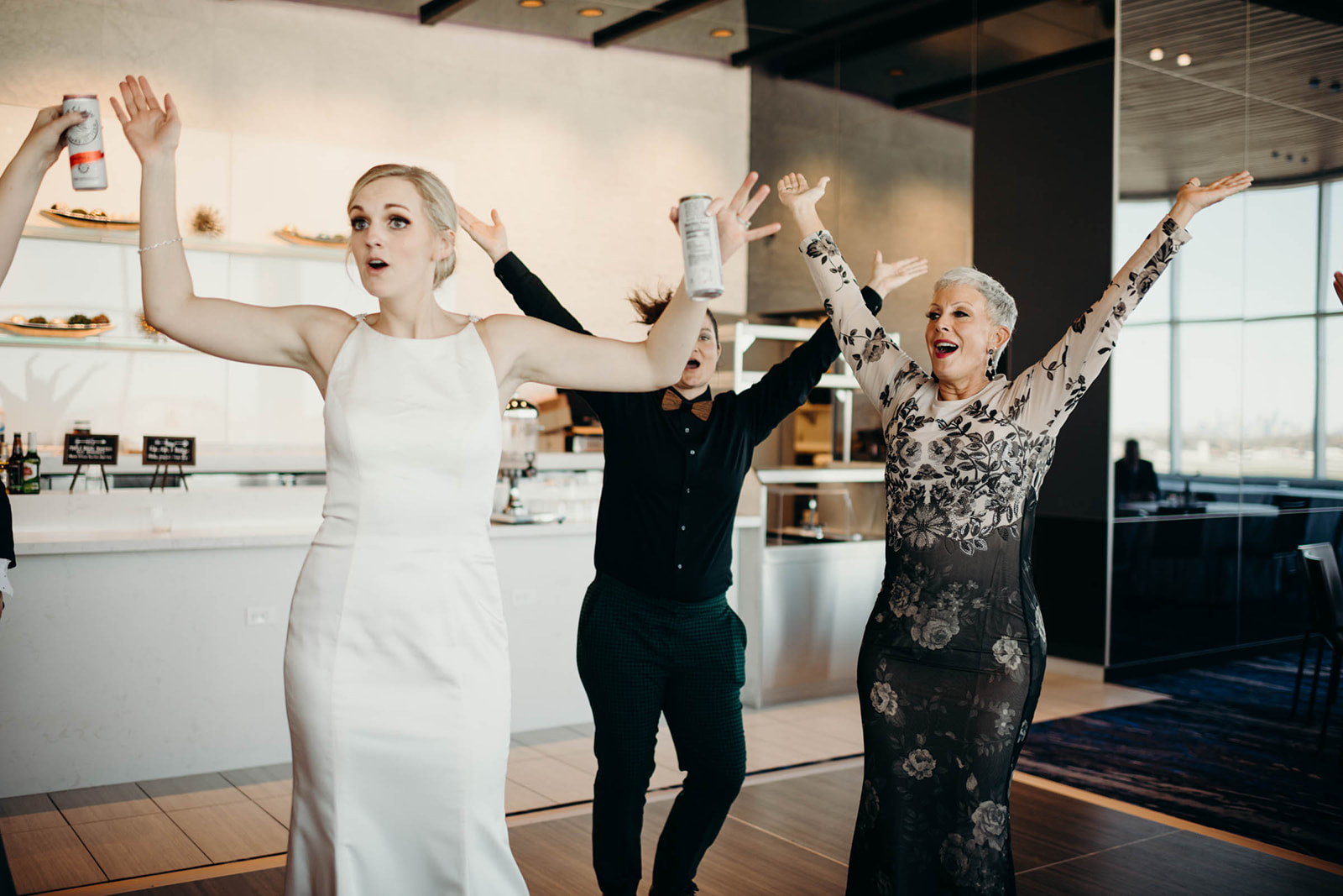 Bride dances with mother at wedding reception