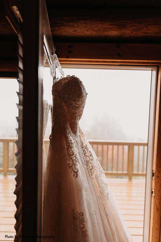 Bridal gown with beaded bodice and sequined tulle
