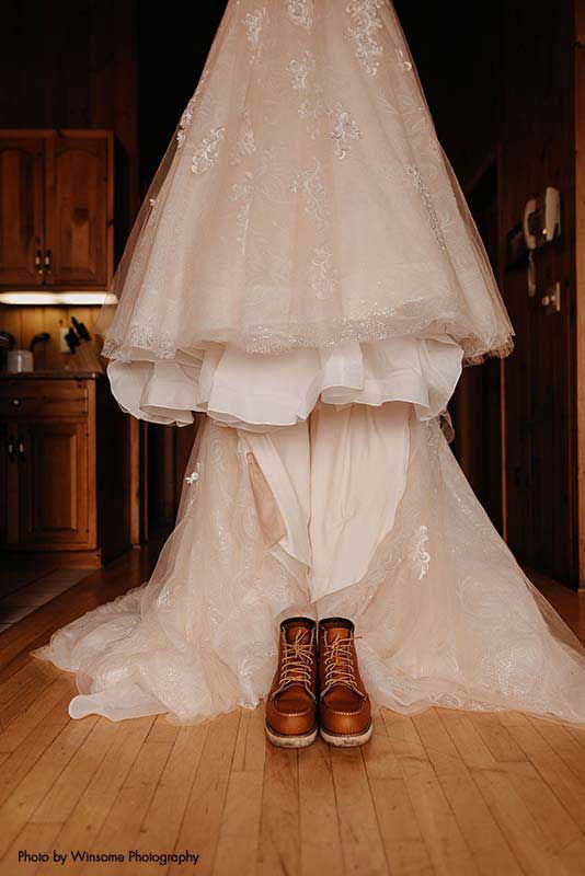 Red wing boots sit beneath bridal ballgown