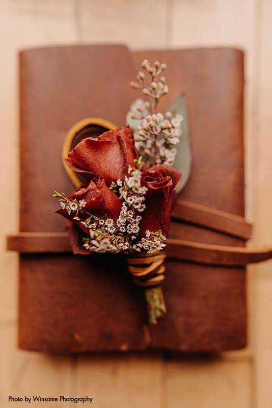 Fall boutonnière with rose and dried floral