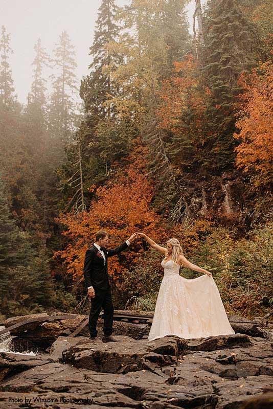 Groom twirls bride at North Shore Wedding