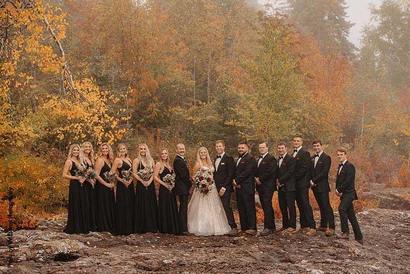 Wedding party in dark wedding attire