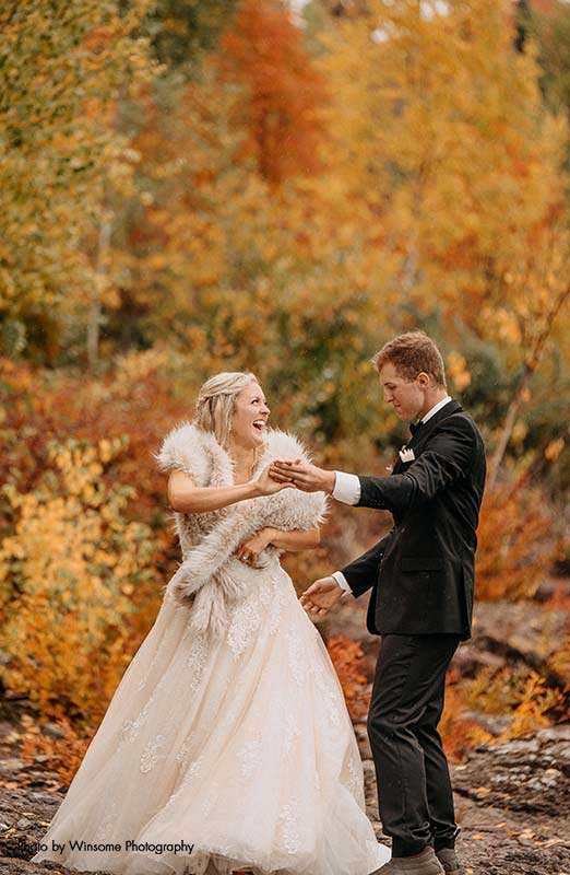 Bride in tulle sequin ballgown is twirled by groom in black suit