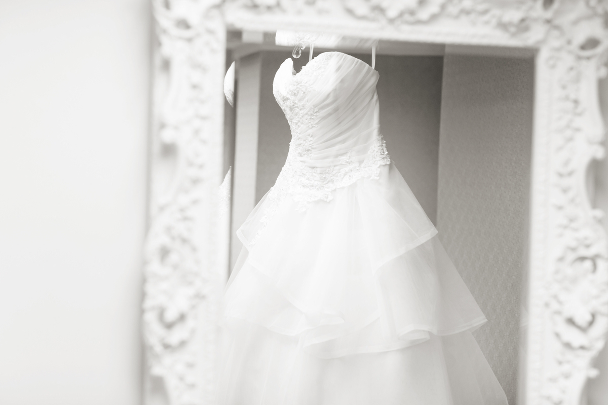 Sweetheart strapless ballgown hands from mirror