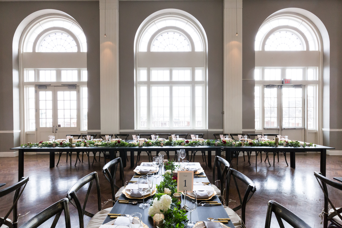 Harvest-style table seating at wedding in Minneapolis, MN